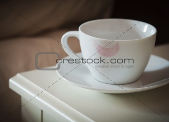 Lipstick mark on coffee cup