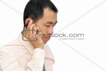 Mature business man using cellphone