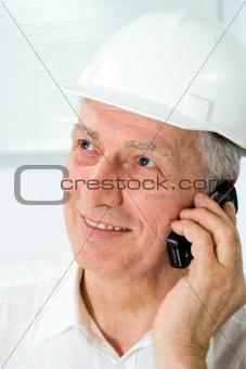 old builder in the helmet