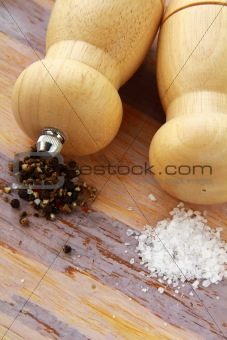 Wooden salt and pepper pot over wooden  background