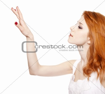 Red-haired girl tuching something in the air.