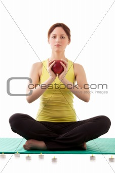 woman in sportswear with apple