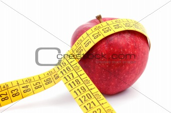 Apple and measuring tape on white