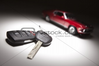 Car Keys and Sports Car Under Spot Light.