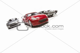 Several Sports Cars Racing Isolated on a White Background.