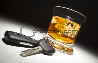 Alcoholic Drink and Car Keys Under Spot Light.