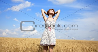 Young beautiful girl at wheat field.