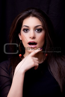 Attractive young woman, showing enthusiasm, wondering