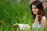 Beautiful young woman reading