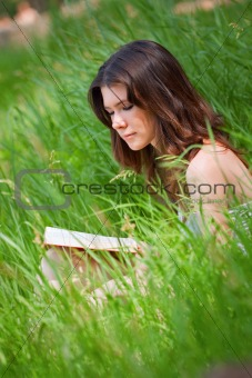 Beautiful young woman reading