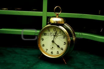 Old gold alarm clock