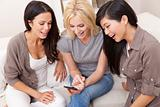 Three Beautiful Women Friends Using Smart Phone