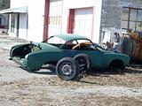 Classic car in pieces