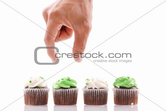 Hand About to Pick a Cup Cake to Eat