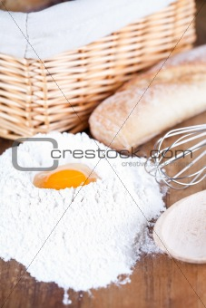 bread, eggs, whisk and flour