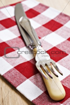 Antique knife and fork on a cloth