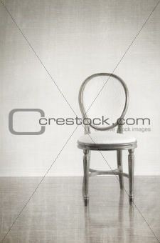 Antique chair with grunge style background
