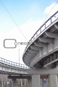 automobile overpass on background of blue sky with clouds. botto
