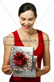 Attractive young woman looking in a gift box