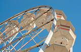 Retro Ferris Wheel Against Blue Sky