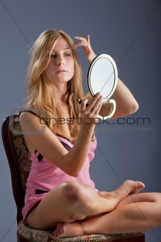 beautiful woman with mirror
