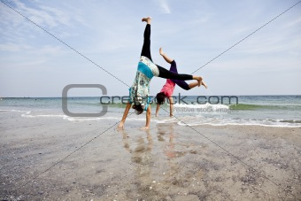 acrobatics on the beach.