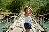 The girl goes on a bridge