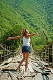 Girl on a mountain bridge