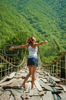 Girl on a mountain bridge