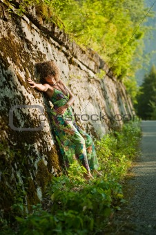 Beatiful girl near wall