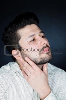 Attractive man over dark background