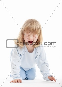 boy with long blond hair on the floor, screaming - isolated on white