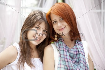 Portrait of two beautiful girls at outdoor.