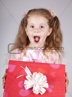 Beautiful young girl with box