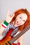 Smiling red-haired Italian girl with guitar