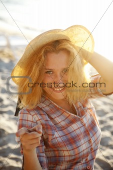 Portrait of beautiful blonde girl in cap