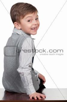 Boy sitting on desk