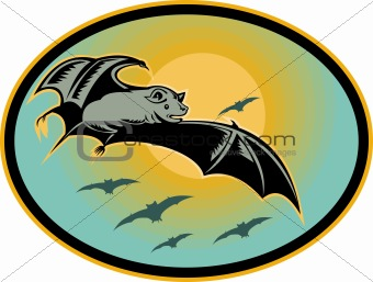 Bat flying with moon in background