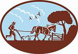 farmer and horse plowing field retro