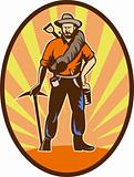 Miner, prospector or gold digger with pick axe and shovel 