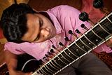 Indian Man Plays a Sitar