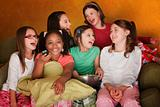 Group Of Little Girls Watch Television