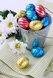Bucket filled with chocolate eggs Easter sweets