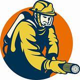 Firefighter or fireman aiming a fire hose