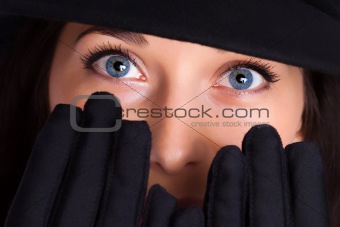 Portrait of a beautiful brunette young woman with gloves
