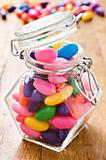 Colorful jelly beans in a bottle - very shallow depth of field