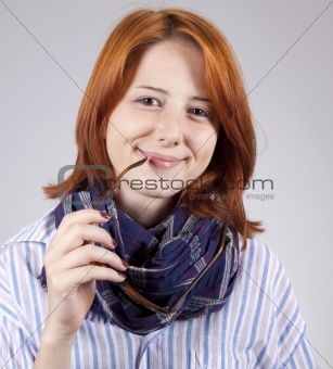 Young  smiling fashion girl in glasses