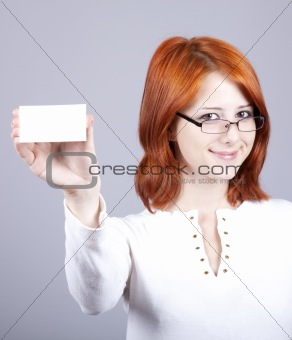 Portrait of an young beautiful happy woman with blank white card