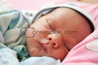 Beautiful one week old baby boy asleep