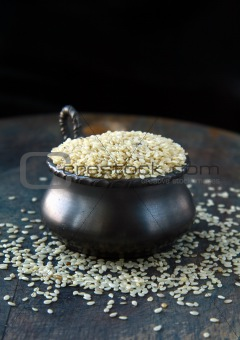 Close up of sesame seeds on a wood table